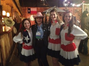 Marsha Firestone, Ph.D., WPO President & Founder, poses with the Wildcat Wranglers